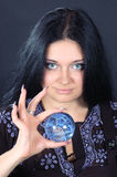 Beautiful witch with magic sphere Stock Photo