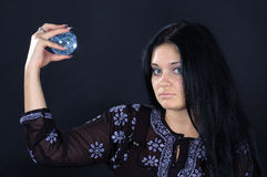 Beautiful witch with magic sphere Royalty Free Stock Photo