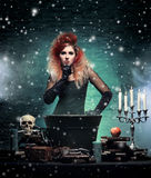 Beautiful witch making the witchcraft in the dungeor Stock Photos