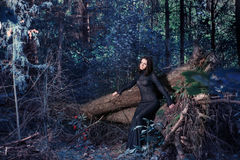 Beautiful witch posing in mystic forest Royalty Free Stock Images