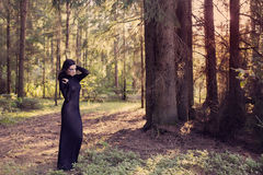 Beautiful witch posing in  mystic forest Royalty Free Stock Photography