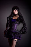 Beautiful witch in purple and black outfit Stock Photos