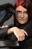 Beautiful witch with raven Stock Photo