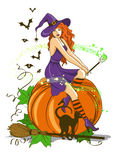 Beautiful witch sitting on the pumpkin Stock Photography