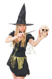 Beautiful witch with skull isolated on white Stock Images