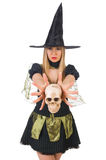 Beautiful witch with skull isolated on white Stock Photography