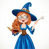 Beautiful witch wearing in blue dress holding a magic wand Royalty Free Stock Photo