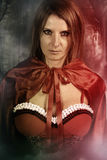 Beautiful witch wearing a red hood Stock Photo