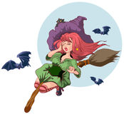 Beautiful witch woman flying on broomstick. Halloween story Stock Photo