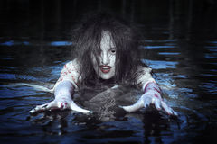 Beautiful witch woman standing in the river Royalty Free Stock Photography