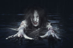 Beautiful witch woman standing in the river Stock Images
