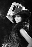 Beautiful woman. Portrait of the beautiful young woman in a hat. black-and-white image Stock Image