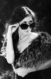 Beautiful woman. Portrait of the beautiful young woman in dark glasses. black-and-white image Stock Photography