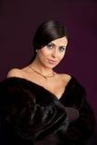 Beautiful woman. Woman in a fur coat Royalty Free Stock Photo