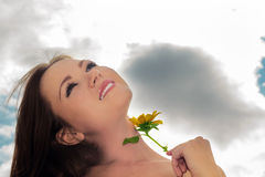 Beautiful woman. Portrait of beautiful woman with flower against the sky royalty free stock photo