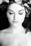 Beautiful woman. A beautiful young woman with flowers in her hair Royalty Free Stock Photo