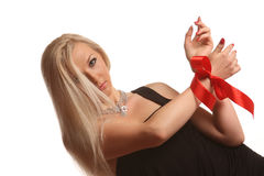 Beautiful woman. With red bow Royalty Free Stock Image