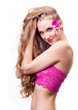 Beautiful woman. Beautiful young woman with creative makeup with tulip petals and long curly hair Stock Photography