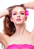 Beautiful woman. Beautiful young woman with creative makeup with tulip petals and long curly hair Royalty Free Stock Photo