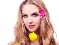 Beautiful woman. Beautiful young woman with a flower and creative makeup with tulip petals Royalty Free Stock Images