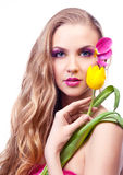 Beautiful woman. Beautiful young woman with a flower and creative makeup with tulip petals Stock Photo