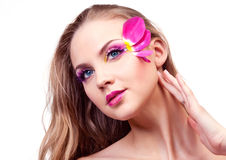 Beautiful woman. Beautiful young woman with creative makeup with tulip petals Royalty Free Stock Photography