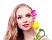 Beautiful woman. Beautiful young woman with a flower and creative makeup with tulip petals Royalty Free Stock Photography