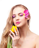 Beautiful woman. Beautiful young woman with a flower and creative makeup with tulip petals Stock Photography