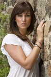 Beautiful Woman. A Beautiful Woman standing against a rock wall Royalty Free Stock Photography