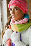 Beautiful woman. A beautiful woman in warm clothes standing near the window Royalty Free Stock Photo