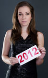Beautiful woman with 2012 sign Stock Photo