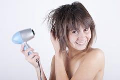 Beautiful woman. Human fashion - beautiful woman drying her hair by dryer royalty free stock photo