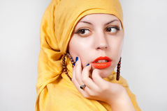 Beautiful woman. Young beautiful woman portrait with yellow scarf Royalty Free Stock Images
