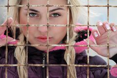 Beautiful woman. In winter  in jail Royalty Free Stock Photography