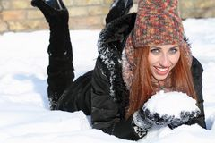 Beautiful woman. Happy girl with snow in the winter Royalty Free Stock Images
