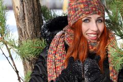 Beautiful woman. Happy girl with snow in the winter Stock Images