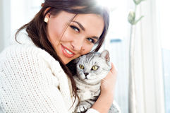 Beautiful woman. With cute cat Royalty Free Stock Image