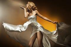 Beautiful woman. Wearing white dress Royalty Free Stock Images