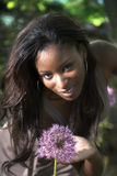Beautiful Woman. Beautiful African American woman in the garden Stock Image