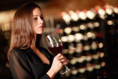 Beautiful woman. Beautiful girl in the wine cellar Stock Photo