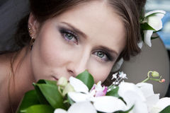Beautiful Woman. Attractive young woman face with flowers Stock Photography
