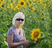 Beautiful woman. Alone among sunflowers Stock Images