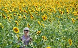 Beautiful woman. Alone among sunflowers Stock Photos