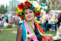 A beautiful woman. On his head a crown of flowers Royalty Free Stock Photos