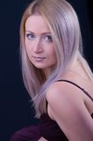 Beautiful woman. Attractive young woman with violet hair Stock Photography