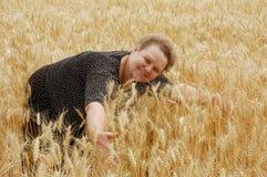 Beautiful woman. On the wheat field Royalty Free Stock Photo
