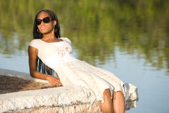 Beautiful Woman. Beautiful Young African American Woman Laying Outdoors Stock Image