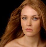 Beautiful Woman. Image of a Beautiful Woman on black Background Stock Photography