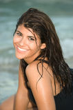 Beautiful woman. Beautiful Brunette Woman Smiling at the beach Royalty Free Stock Image