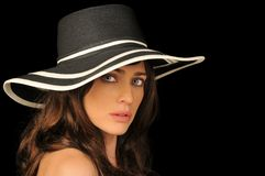 Beautiful Woman. Portrait of beautiful brunette with black and white hat Stock Image